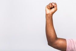Close-up photo of nice handsome african american man's hand showing breakthrough gesture holding fists raising hands up isolated over white background.
