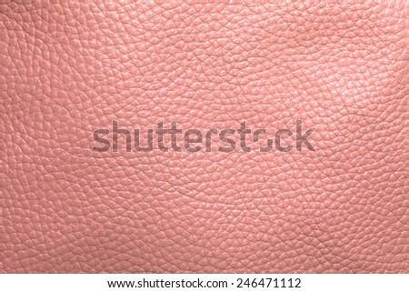 Close up photo of pink  color filtered leather surface texture style represent the surface background.