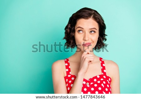 Close up photo of pondering charming interesting confused girl thinking over changing job while isolated with teal background Stockfoto ©