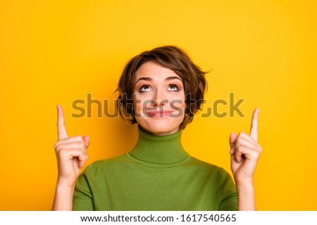 Close up photo of positive cheerful girl promoter point index finger copy space suggest  select adverts promotion wear stylish clothing isolated over vibrant color background