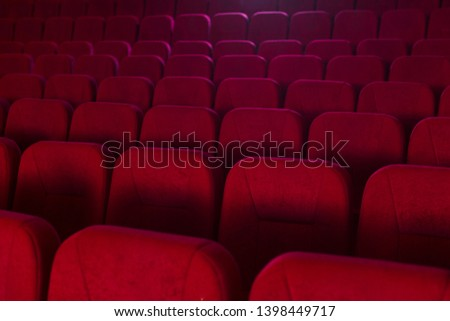 Close-up photo of rows of red seats in the cinema. #1398449717