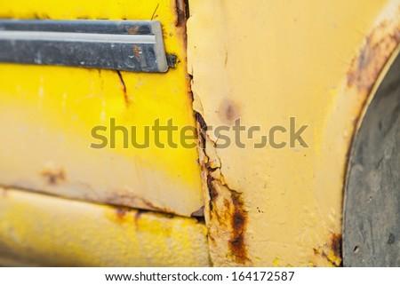 Close up photo of rusty yellow car