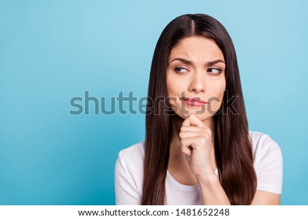Close up photo of suspicious attractive woman looking for answers on her questions while isolated with blue background Сток-фото ©