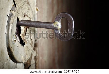 CLose-up photo of the old key inserted into the damaged lock
