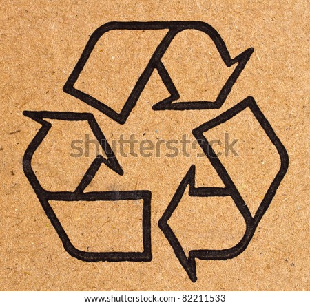 close up photo of the recycle symbol printed on a recycled cardboard box, background