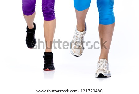 Close-up photo of two woman's legs running on a white background