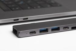 Close-up photo of type-c hub and laptop. Minimalistic