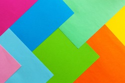 Close up photo of varicoloured colorful paper background. Top view, spring and various holidays and events concept