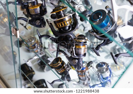 Close-up photo of variety baitcasting reel in the fishing store