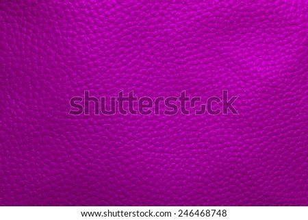 Close up photo of violet color filtered leather surface texture style represent the surface background.
