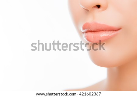Close up photo of woman's lips with natural make up on white background #421602367