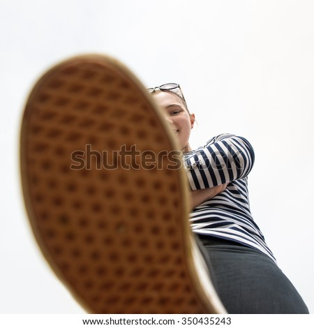 Close-up photo of woman shoes making the step