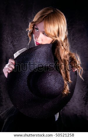 Close up photo-session of the young beautiful  woman with dark hat