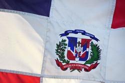 Close up photo shot of wavy Dominican Republic flag.