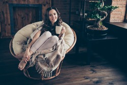 Close up photo sweet beautiful brunette she her lady kindhearted melting living room morning relaxing hot beverage covered blanket wearing domestic home apparel clothes outfit sit comfy arm-chair