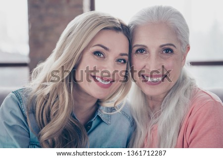 Close up photo two amazing she her ladies mom granddaughter child granny grandmother hugging hold close lovely wear casual domestic clothes sit comfy cosy couch divan flat house indoors