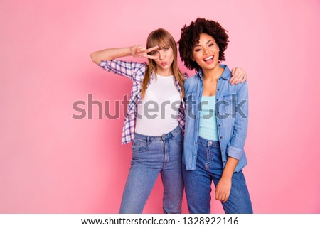 Close up photo two funky diversity she her ladies different race playful send kiss hug embrace cuddle show v-sign eye wear casual jeans denim checkered shirt clothes outfit isolated pink background #1328922146