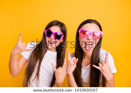 Close up photo two people beautiful her she diversity lady different age buddies rock concert fans impolite wear colorful specs casual white t-shirts jeans denim isolated yellow bright background