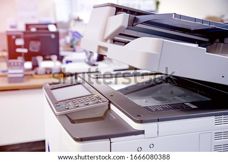 Photo of  Close-up photocopier or printer is office worker tool equipment for scanning and copy paper.
