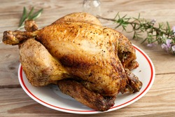 Close up photograph of a good chicken cooked on a spit.