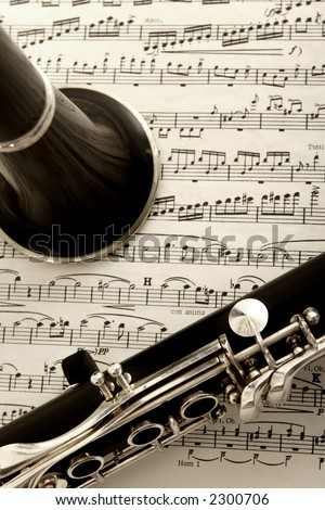 close up photograph of clarinet and sheet music