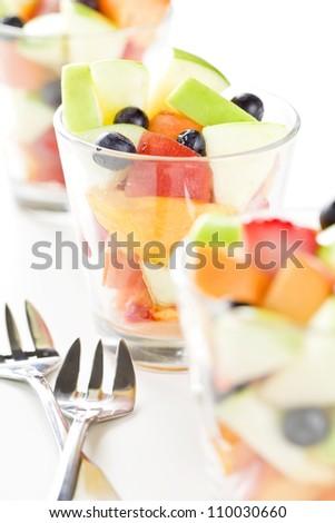 Close up photograph of three glasses of fresh fruit salad