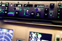 Close up photography of a Boeing 777 simulator autopilot