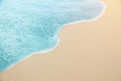 close up photography - Tropical Blue sea water coming on the white beach sand