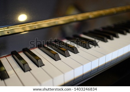 Close-up piano keyboard instrument with shining background. selective focus #1403246834