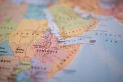 Close up picture focused on Djibouti on a colorful map of the Horn of Africa with its main routes marked in red and with the rest of the countries blurred out