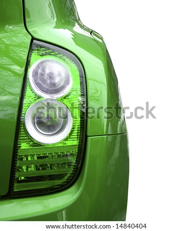 Close-up picture of a car headlight  isolated on white.