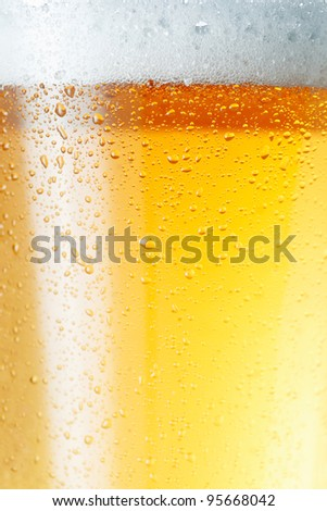 Close-up picture of a condensation on the glass of beer.