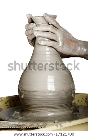 Close-up picture of a potter works a potter's wheel - stock photo