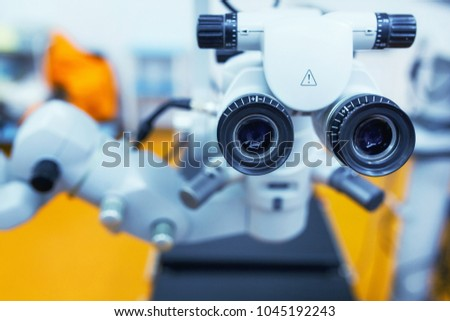 close up picture of an operating microscope in a laboratory. Ophthalmologist. medical, health, ophthalmology concept