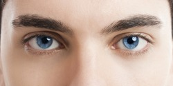 Close-up picture of blue eyes from a young man