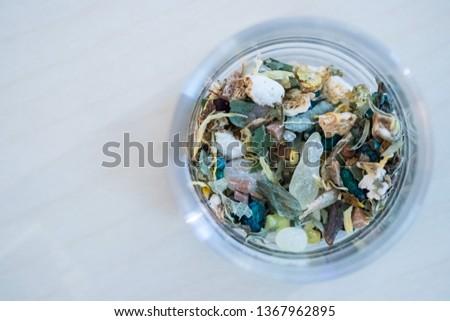 Close up picture of dried incense in a glass bowl #1367962895