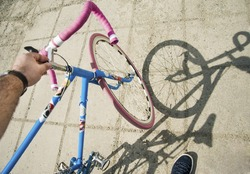 close up picture of mans hand on sport bicycle bars, man hands with black watches, blue classic bicycle. Cycling in the park,  hipster man with vintage bike. Hipster style. no face.