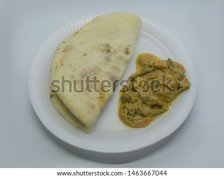 Close up picture of mix vegetable curry server with tandoori roti