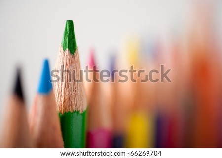 Close-up picture of multicolor pencils. Very shallow focus on green pencil