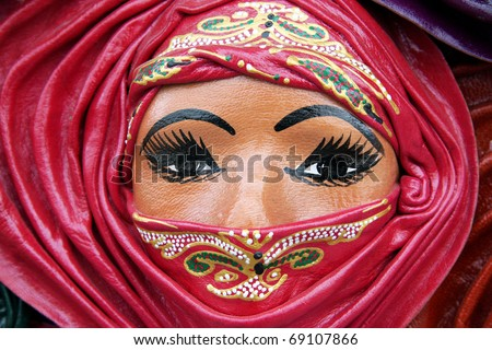 close up picture of oriental decorative mask representing a Muslim woman wearing a veil