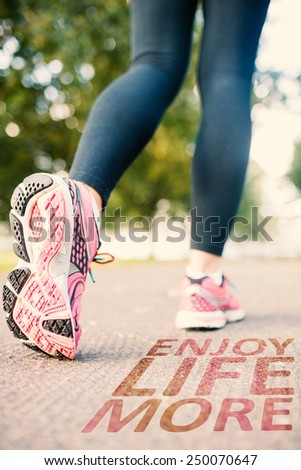 Close up picture of pink running shoes against enjoy life more