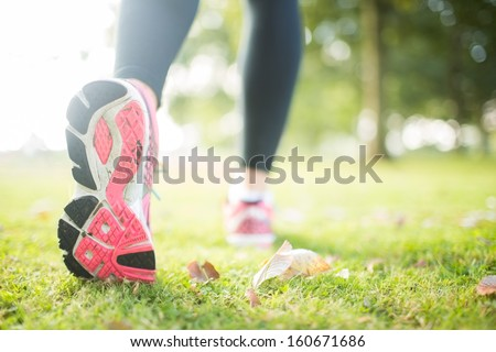 Close up picture of pink sole from running shoe in a park on a sunny day #160671686