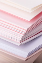 Close up pink and white pages of a open book, vertical