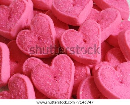 close-up pink heart sugar cookies