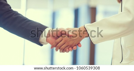 close up  politeness of businessman handshake with partner vendor,collaboration of ceo leader hand shake for agreement or deal financial cooperative concept.