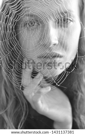 close-up portrait beautiful girl with focus on a spider web-Image #1431137381