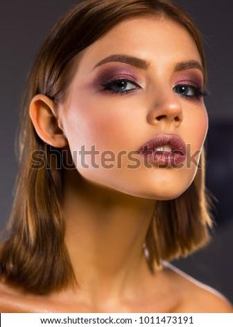 Close-up portrait. Bright beautiful make-up. Eyes hadow. Shine. Lips. #1011473191