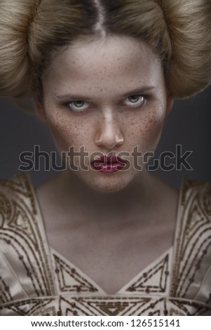 close-up portrait fashion beauty model with freckles on dark grey background