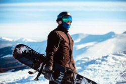 Close up portrait guy holding snowboard in winter, sports wear, helmet, sunglasses, winter, up, freedom, nature, attractive, clothes, sport, competitions, winter holidays, alps, travel, hiking