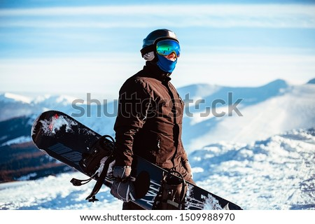 Close up portrait guy holding snowboard in winter, sports wear, helmet, sunglasses, winter, up, freedom, nature, attractive, clothes, sport, competitions, winter holidays, alps, travel, hiking Stock fotó ©